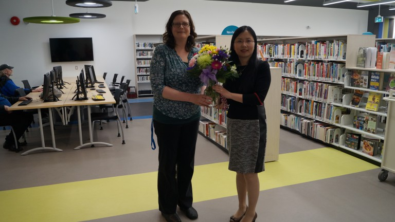 Lara Wright, Library Manager – Wellington Branch is welcomed to Country Club by Crystal Zhang.